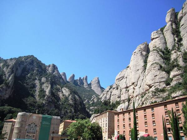 Photograph - Amazing Montserrat Mountain Rock Encapsulated Buildings Near Barcelona Spain by John Shiron