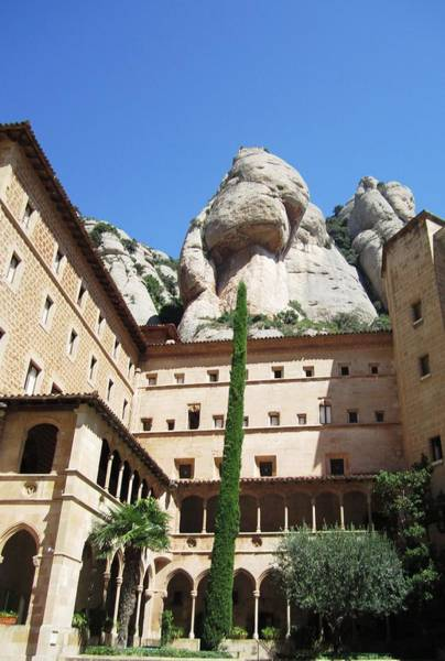 Photograph - Amazing Montserrat Mountain Rock Encapsulated Moorish Building Near Barcelona Spain by John Shiron