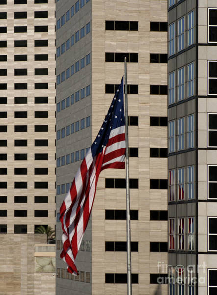 North American Photograph - American Flag In The City by Blink Images