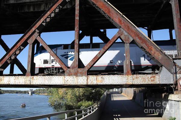 Amtrak California Crossing The Old Sacramento Southern Pacific Train Bridge . 5d18571 Art Print