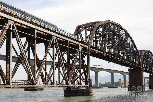 Carquinez Bridge Wall Art - Photograph - Amtrak Train Riding Atop The Benicia-martinez Train Bridge In California - 5d18768 by Wingsdomain Art and Photography