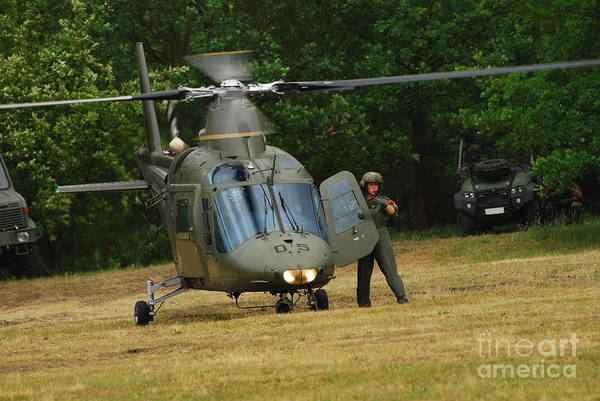 Utility Helicopter Photograph - An Agusta A109 Helicopter by Luc De Jaeger