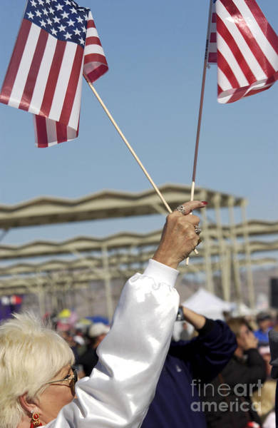 Photograph - An Air Show Spectator Waves Her Flags by Stocktrek Images