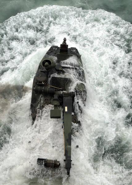 Aav Photograph - An Amphibious Assault Vehicle Leaves by Stocktrek Images