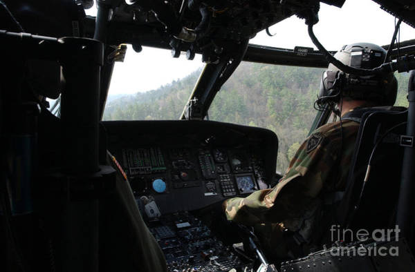 Utility Aircraft Photograph - An Army National Guard Uh-60 Black Hawk by Stocktrek Images