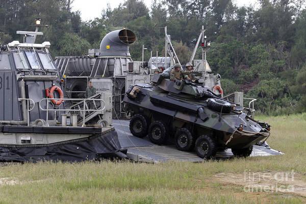 Aav Photograph - An Assault Amphibious Vehicle Exits by Stocktrek Images