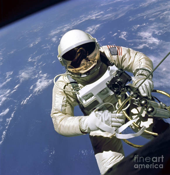 Photograph - An Astronaut Floats And Maneuvers by Stocktrek Images