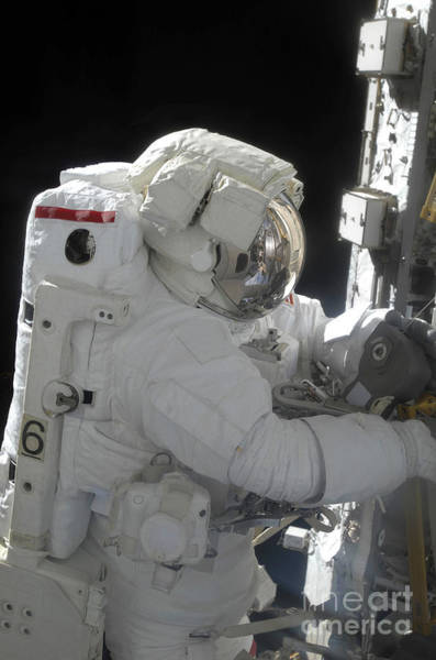 Photograph - An Astronaut Performs A Task by Stocktrek Images