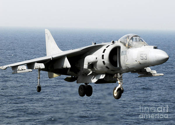 Landing Gear Photograph - An Av-8b Harrier Hovers Over The Flight by Stocktrek Images