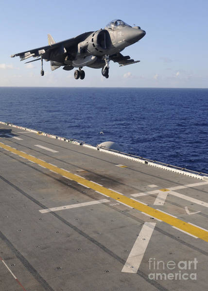 Amphibious Assault Ship Wall Art - Photograph - An Av-8b Harrier Jet Prepares To Land by Stocktrek Images