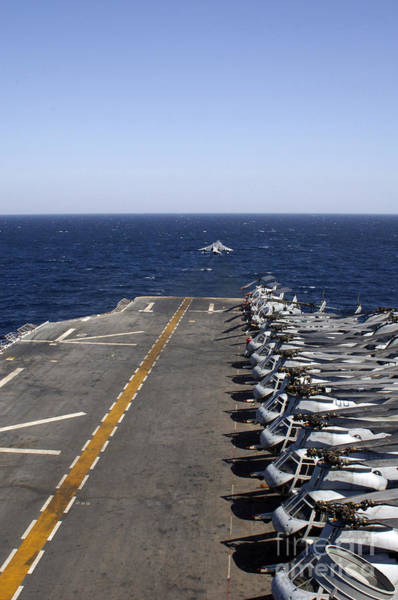 Photograph - An Av-8b Takes Off From The Flight Deck by Stocktrek Images