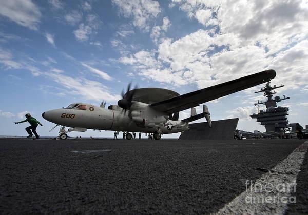 Uss Carl Vinson Photograph - An E-2c Hawkeye Aircraft Prepares by Stocktrek Images