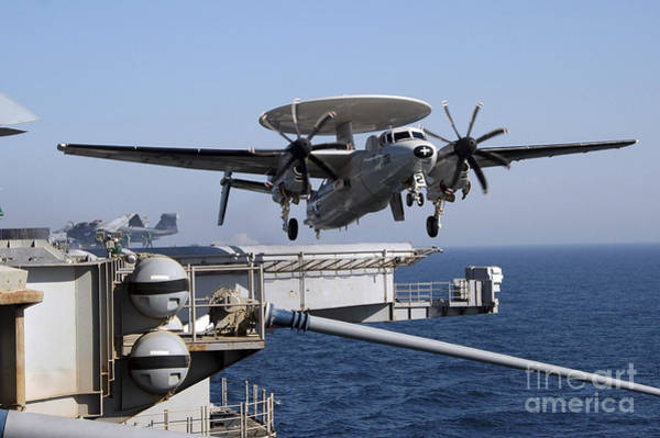 Photograph - An E-2c Hawkeye Launches Off The Flight by Stocktrek Images