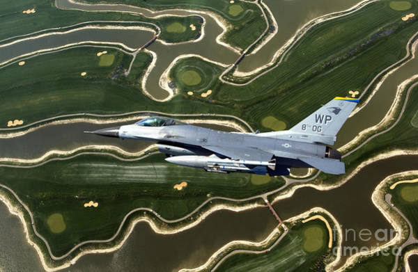 Photograph - An F-16 Fighting Falcon Flies Near Base by Stocktrek Images