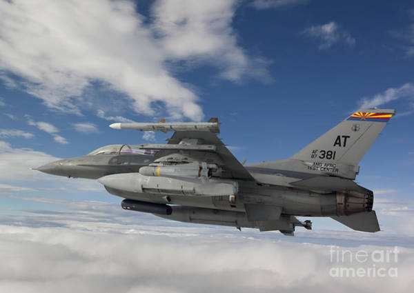 National Guard Photograph - An F-16 Fighting Falcon Flies With An by HIGH-G Productions