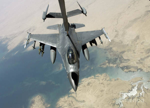 Photograph - An F-16 Fighting Falcon Refuels by Stocktrek Images