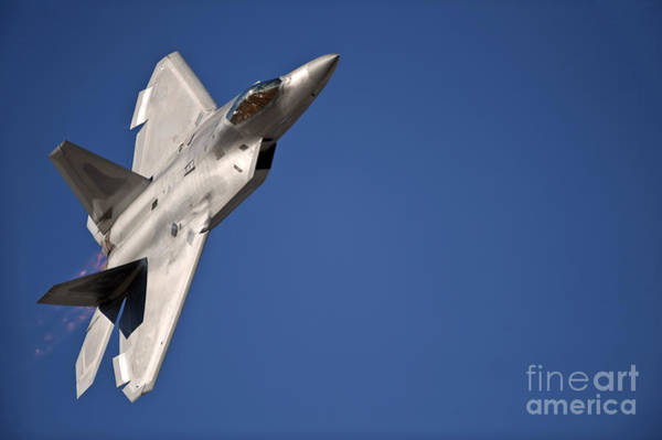 Photograph - An F-22 Raptor Aircraft Performs by Stocktrek Images