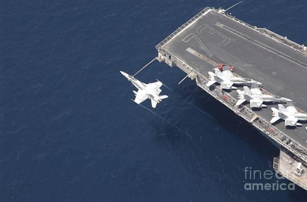 Photograph - An Fa-18 Hornet Flys Over Aircraft by Stocktrek Images
