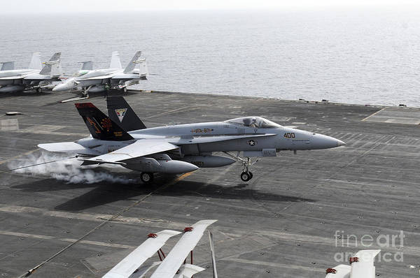 Flight Deck Photograph - An Fa-18a+ Hornet Lands Aboard by Stocktrek Images