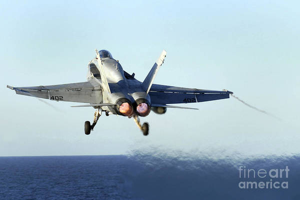 Photograph - An Fa-18c Hornet Launches by Stocktrek Images