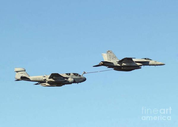 Prowler Photograph - An Fa-18e Super Hornet Performs An by Stocktrek Images