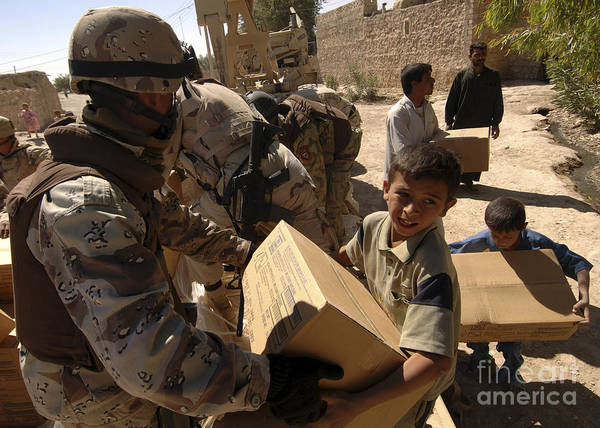 Photograph - An Iraqi Army Soldier Handing A Box by Stocktrek Images