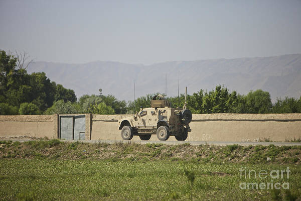Atv Photograph - An M-atv Driving Towards Aliabad by Terry Moore