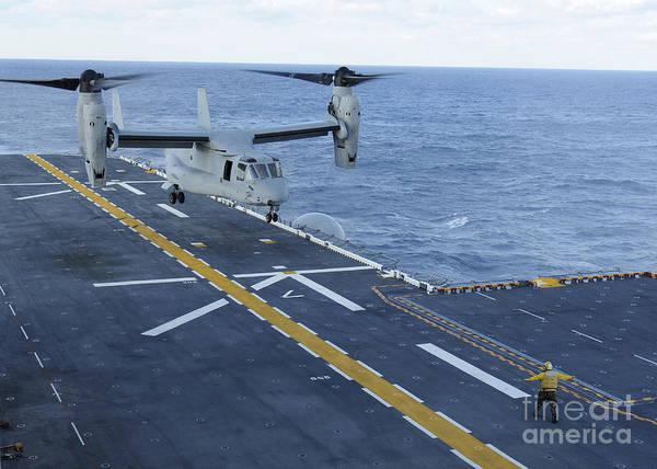 Mv-22 Photograph - An Mv-22 Osprey Lands Aboard by Stocktrek Images