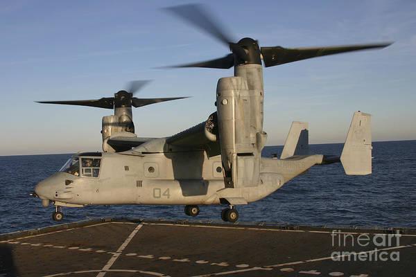 Mv-22 Photograph - An Mv-22 Osprey Lands Aboard Usns by Stocktrek Images