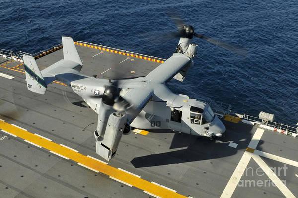 Mv-22 Photograph - An Mv-22 Osprey Lands Aboard Uss by Stocktrek Images