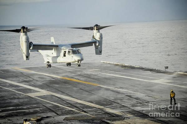 Mv-22 Photograph - An Mv-22 Osprey Lands On The Flight by Stocktrek Images