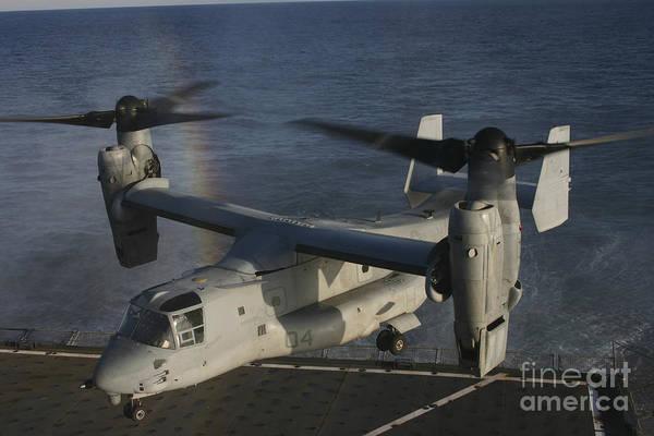 Mv-22 Photograph - An Mv-22 Osprey Prepares To Land Aboard by Stocktrek Images