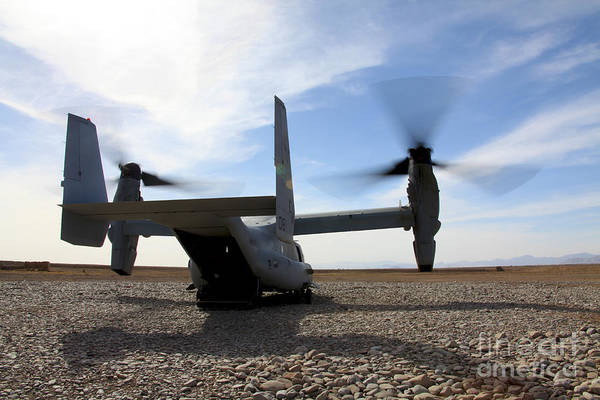 Mv-22 Photograph - An Mv-22 Osprey Sits Outside A Forward by Stocktrek Images