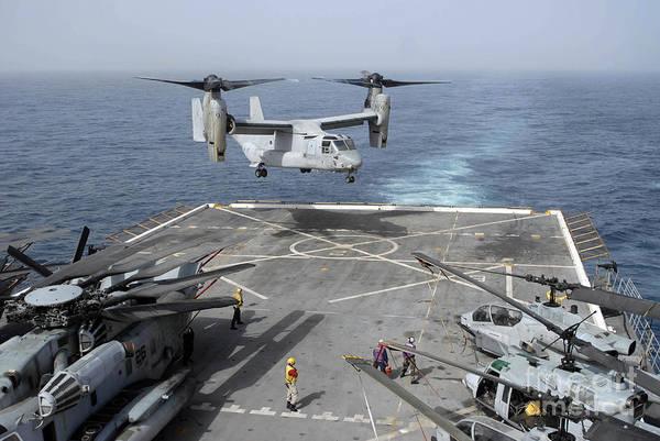 Mv-22 Photograph - An Mv-22b Osprey Lands Aboard by Stocktrek Images