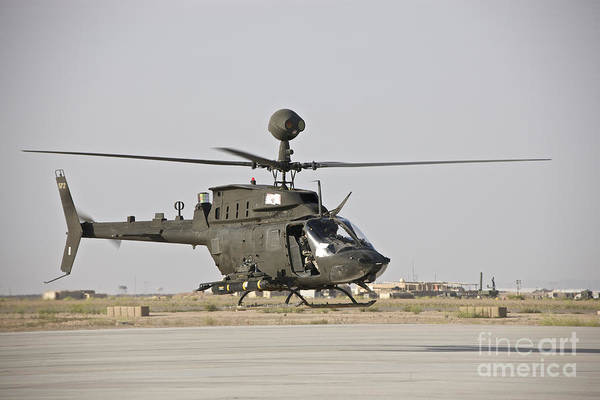 Kiowa Photograph - An Oh-58d Kiowa Helicopter Takes by Terry Moore