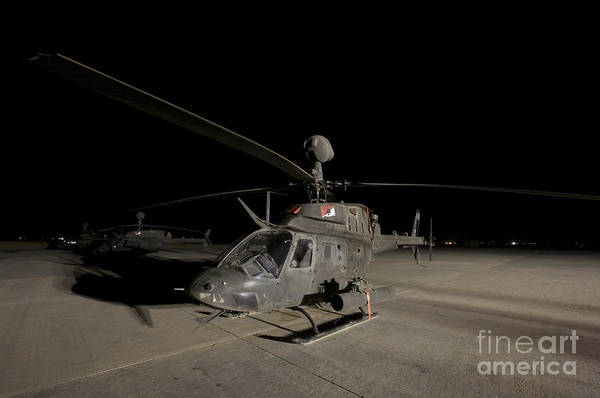 Kiowa Photograph - An Oh-58d Kiowa Sits On Its Pad by Terry Moore