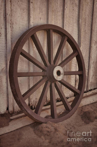 Photograph - An Old Wagon Wheel by Donna Greene