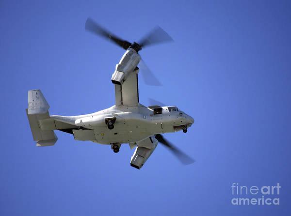 Mv-22 Photograph - An Osprey Tiltrotor Aircraft In Flight by Michael Wood