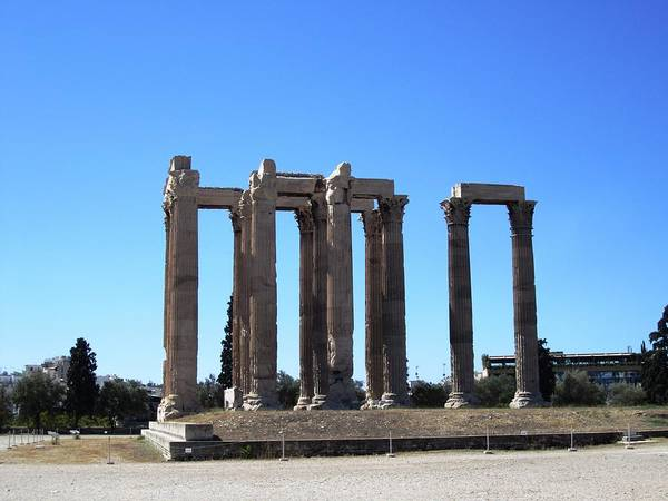 Photograph - Ancient Remains Of Tall Pillars In Athens Greece by John Shiron
