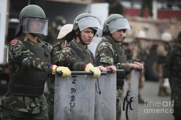Bracing Photograph - Argentine Marines Dressed In Riot Gear by Stocktrek Images