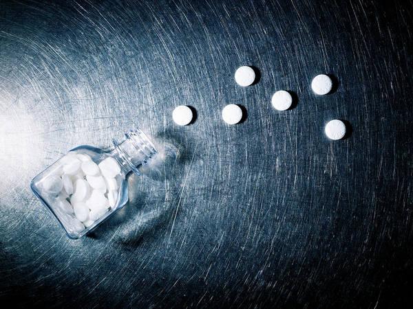 Wall Art - Photograph - Aspirin Spilled From Bottle On Stainless Steel. by Ballyscanlon