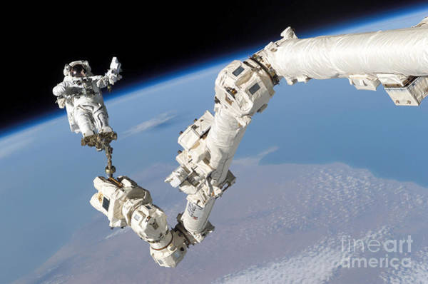 Photograph - Astronaut Anchored To A Foot Restraint by Stocktrek Images