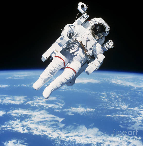 Photograph - Astronaut Floating In Space by Stocktrek Images