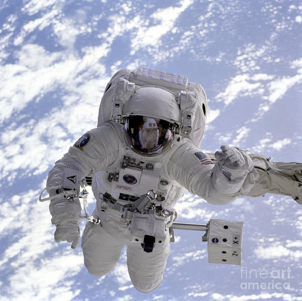 Photograph - Astronaut Gernhardt On Robot Arm by Nasa