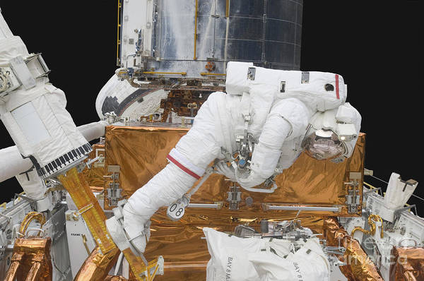 Photograph - Astronaut Working On The Hubble Space by Stocktrek Images