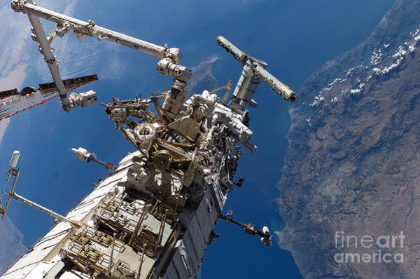 Photograph - Astronauts Traversing Along The Side by Stocktrek Images