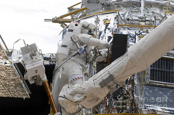 Photograph - Astronauts Working On The Hubble Space by Stocktrek Images