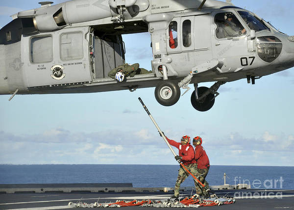 Uss George Washington Wall Art - Photograph - Aviation Ordnancemen Hook A Pallet by Stocktrek Images