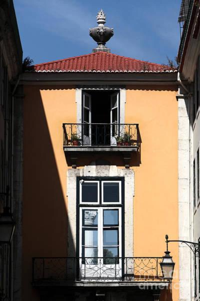 Wall Art - Photograph - Balconies In Lisbon by John Rizzuto
