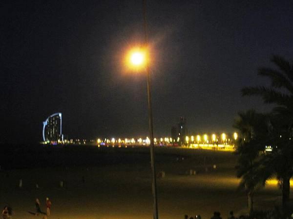 Photograph - Barcelona Beach Pier II By Night Light Pole In Spain by John Shiron